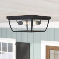 With a simple and clean-lined square design, this outdoor flush mount is perfect for traditional aesthetics. It is crafted from metal, with an oil burnished bronze finish and a clear glass shade. The light accommodates two medium-base light bulbs, of up to 60 W each (bulbs not included). Designed for damp environments, you can rest assured that this hardwired fixture is safe on your covered patio or porch.