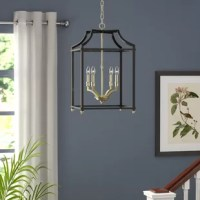 Illuminate your space in curated, transitional style with this four-light lantern pendant! Crafted of sturdy steel in a fashionable finish, this fixture features an open, airy cage frame accented by decorative finials. Inside, capping streamlined candle-style lights, four 60 W incandescent B10 candelabra bulbs (not included) disperse ambient light throughout your space. An adjustable length of the chain suspends the whole unit from a sloped ceiling-compatible canopy above to round out the...