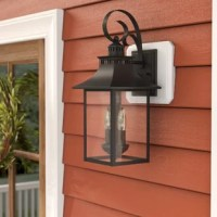 Blending traditional charm and contemporary appeal, this two-light illuminates any garage, patio, or porch in tasteful, transitional style! Crafted of steel in a weather-resistant finish, this fixture features a raised rectangular backplate with a beveled edge. Suspended from a dramatic scrollwork hook arm, a lantern-style light features a vented mansard roof and a chimney, while its clean-lined cage frame is lined with clear glass panels. Rated for safe use in wet outdoor locations, this...