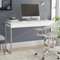 Steeped in Scandinavian style, this clean-lined writing desk brings a touch of modern minimalism to your office. Crafted in Denmark, this budget-friendly piece is founded atop a sled-style metal frame finished in silver with a neutral wooden top for a subtle contrast.