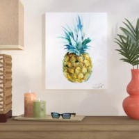 Showcasing the symbol for welcome and hospitality, this pineapple painting print brings a splash of tropical style to any open wall in your home. Proudly made in the USA, this design is dotted with yellow, blue, and green hues up against a neutral white background for a contrasting pop of color. Best of all, this artful accent arrives ready to display in any space as soon as it reaches your door.