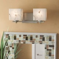 Cast a warm glow over your powder room arrangement with this two-light LED vanity light. Crafted of metal, this fixture features a clean-lined design with an angular rod that supports two 9 W LED bulbs. Its rectangular plastic resin shades mimic the appearance of alabaster for a distinctive look, showcasing cream and brown hues that blend with most color palettes. Since this luminary is reversible, you can decide whether to shine a light upward or downward – you know what suits your space...