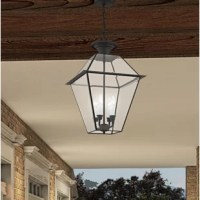 Blending traditional elements with contemporary style, this four-light outdoor hanging lantern is a versatile touch for adding classic style to any screened-in sunroom or covered porch. Crafted from metal with clear beveled glass panels, this piece strikes an empire silhouette accented by a turned finial. Inside, four candle-style lights that accommodate 60 W bulbs (not included) wash your space in light. And since it's designed for damp spaces, it'll stay bright even on misty days.