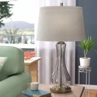 Searching for a solution for your understated nightstand? Switch up your aesthetic in shining style with this 29.5'' table lamp, an ideal investment for any master suite! Crafted from glass with a smoke gray hue, its base showcases a curved silhouette with textured details. Up top, the look is leveled out with a single light highlighted by a tapered fabric shade to evenly distribute the warm glow throughout your bedside ensemble.