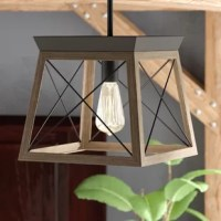 Create a cozy and comfortable home atmosphere with the classic barn-like touch of the One-Light Rustic Mini-Pendant. The open-caged light fixture features a faux-wood frame with a rich painted finish. A farmhouse-inspired X-brace design stretches across each side of the frame recalling old barn doors and rustic farmhouse gates. From inside the enclosure peeks a metal light base waiting to hold a light source as it exudes a comforting country glow. A bold plate accents the top of the structure...