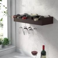 Keep all your favorite vintages organized and within reach with this five-bottle wall-mounted wine rack. Crafted of solid and manufactured wood in a rich espresso finish, this streamlined design strikes a rectangular silhouette measuring 4