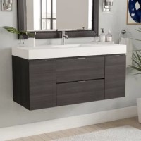 Modern charm meets contemporary flair with this vanity base. This single vanity set is crafted of wood, with a reinforced acrylic composite top, and integrated acrylic sinks. It features two cabinets, and two drawers for plenty of concealed storage of crisp towels, cleaning supplies and more. This wall-mounted base has a single-hole faucet installation type. Faucet, P-trap, and drain assembly not included.