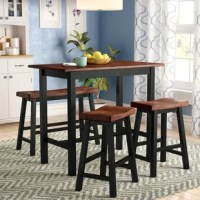 Breakfast nook in need of an update? Create a classic spot to serve up quick breakfasts and weeknight family meals with this four-piece counter height dining set. Featuring a rectangular table, two saddle stools, and a bench, this set offers space to seat four. Crafted from solid rubberwood, each piece pairs clean lines with curves along with neutral finishes of black and medium oak. Assembly is required, with just a Philips screwdriver needed.