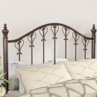 Set a traditional foundation in your restful retreat and imbue your space with timeless elegance with this lovely slat headboard. Inspired by antiqued designs and classic styles, this piece will give your bedroom a look that is fit for a queen. The arched top and rounded posts give this headboard a traditional look, while the slats in the center showcase a twisted design and are accented with scrolling details that elevate the look with artful appeal. Try adding this headboard to your master...