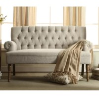 This settee is the perfect pick for a small-scale seating ensemble or a bedroom accent. Made from solid maple wood, it offers a traditional appearance with rolled arms and turned legs finished in walnut. Foam padding and web suspension add comfort to the seat, while 100% polyester upholstery ties it all together with button tufts and a neutral solid hue.