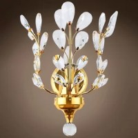 This Mendon 1-Light Candle Wall Light features faceted crystal petals set into charmingly arranged branches. Featuring a radiant finish and finely cut premium grade crystals, this elegant wall light will give any room sparkle and glamour.
