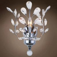 This nature-inspired sparkling ceiling light features faceted crystal petals set into charmingly arranged branches. Featuring a radiant finish and finely cut premium grade crystals, this elegant Mendivil 1-Light Candle Wall Light will give any room sparkle and glamour.