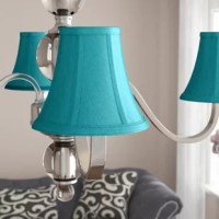 Turn an old flea market find or antique chandelier into a foyer masterpiece with this classic candelabra clip-on shade. Measuring just 6'' W x 6'' D x 5'' H, it's perfect for those small lights on a hanging fixture. This shade showcases a bell silhouette, defined by a soft-back frame and silk upholstery. Plus, it features a neutral solid hue, so it can easily work right into your existing luminary's look.