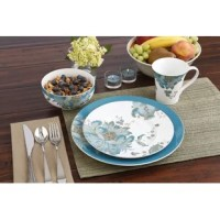 Eliza is dressed to impress with beautiful jewel-toned teals and gold accents. Oversized florals with peacock feather details elegantly and effortlessly add panache to your dinner table.  This sixteen piece set will serve four people in style with its bold rimmed dinner plate, and stunningly decorated salad plate, bowl, and mug.