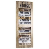 """Add some rules to remember for your household and family unit with this charming hanging wall decor piece that is fashioned to resemble a window shutter. Entitled """"in this house"""", this list is a wonderful way to remind you and your loved ones of some basic rules to lives. Resembling a window shutter and printed with a variety of wood grained sticker backgrounds, this hanging decor piece offers a bit of charm and creativity as well as wonderful reminders on how to live a positive, uplifting..."""