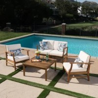 Enhance the functionality of your outdoor sitting area with a new way to enjoy the sunshine and fresh air with loved ones. This assemblage of two stylish club chairs in combination with matching loveseat and coffee table is a superb way to populate your patio with pieces that are both attractive and functional. Crafted from solid acacia wood, with sumptuous cushioning, this set is the perfect place to let the drinks flow and the hours roll by. The cushions are crafted from a polyester blend...