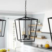 A classic lantern silhouette gets a contemporary refresh with this three-light pendant, perfect for casting a warm and welcoming glow over the foyer. Crafted from metal in a versatile solid finish, this fixture features an angular, tapered shade with open sides for an airy and approachable look. A trio of compatible 40 W candelabra-base bulbs (not included) sits exposed within to offer a boost of brightness. The manufacturer backs this product with a one-year warranty.