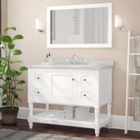 Ready to refresh your bathroom ensemble? This bathroom vanity is the perfect place to start! A charming foundation for your space, it showcases a solid wood frame with clean lines, molded details, and elegantly turned feet. The base is finished in a crisp white hue, which complements the white Italian carrara marble countertop and sleek chrome hardware. It has four drawers and one lower open shelf, which provide ample storage space for all your bathroom essentials.