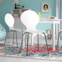 At just 26.25'' H x 14'' W x 13'' D, this pint-sized chair is the perfect pick for your little kiddo. Crafted from metal, its base features four angled legs with a metallic finish for a contemporary appearance. The eye-catching curved seat up top is modern, while a solid hue keeps it understated. Just pull it up to a table and you've got a fun spot for coloring and crafts. Arrives in a set of two.