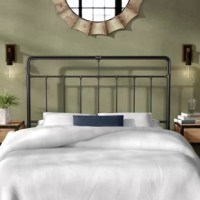 Anchor any guest room or master suite in curated, industrial style with this handsome slatted headboard. Crafted from tubular metal in a dark finish, this charming design strikes an open rectangular silhouette with rounded corners. Its panel of slatted rods is accented with detailed connectors in a gently distressed finish for a well-worn, reclaimed look. Designed to accommodate most standard metal bed frames, this headboard looks best with low-profile box springs.