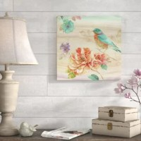 Empty entryway wall? Some spare space in the master suite? A boring bathroom? Wall art instantly turns any blank area into an eye-catching display, all while lending gallery-worthy appeal to your abode. Just take a look at this piece for example: Brimming with garden-worthy glory, it showcases flowers in bloom, butterflies, and a bird in hues of blue and orange. Best of all, this product is proudly made right here in the USA.