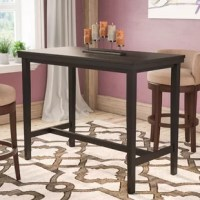 Dining tables are the center of attention in your dining area – they hold food and drinks during parties and everyone ends up sitting around them and talking. Don't let your table get the wrong kind of attention, upgrade your dining experience with this counter height table. This fixed rectangular table is constructed from solid and manufactured wood, in a dark brown finish, and accommodates six people.