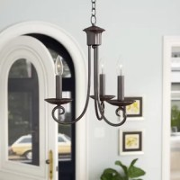 Measuring 16'' H x 14'' W, this mini chandelier packs a big style punch into a small space! Awash in traditional charm, this design's three curved arms hold aloft candle-esque fixtures that accommodate up to 60 W bulbs (not included) that cast a soft white glow in your abode. An oil-rubbed bronze finish rounds out the austere look and brings a hint of the Old world to dining rooms and entryways alike.