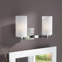 Designed to live in damp areas – like bathrooms with steamy showers – this vanity light is ready to safely shine above your sink. A fine fit for both classic and contemporary aesthetics, its steel frame pairs a clean-lined silhouette with a metallic finish for a transitional look. Its two lights are each highlighted by a cylindrical white etched glass shade, which can be installed facing either up or down.