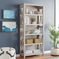 Expand your personal library and display your favorite reads, decorative accents, and potted plants with this bookcase. Featuring five shelves – three of which are adjustable – this manufactured wood piece boasts cottage-style details and tapered legs for a look that's traditionally charming, while x-shaped details on the side round out the look. Wall attachment hardware is included, so you don't need to worry about it tipping over.