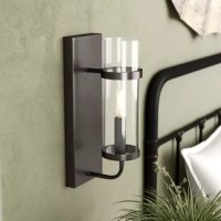Crafted of metal in an English bronze finish, this industrial-inspired one-light wall sconce features a clean-lined rectangular backplate, while two short, tubular arms hold a clean-lined cylindrical shade in place out front. UL-listed for safe installation and use in indoor locals, this unit accommodates one medium candelabra bulb (not included) to disperse bright light throughout your space. This fixture can be mounted and installed in an upright orientation.