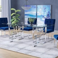 Featuring a clean-lined look that is sure to be a talking point at your next dinner party, this stylish dining table is brimming with contemporary appeal. Made from steel, the chrome base has a geometric design of overlaid squares with a glossy finish. Its tempered-glass tabletop is secured on to the base by gel friction pads, and is 0.5