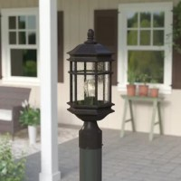 Inspired by classic American dwellings, this post lantern head lends a traditional touch to outdoor areas. Its decorative top finial and lantern-style housing give this fixture its time-honored appearance, while seedy glass shades play up its vintage-inspired side as they protect the interior 100 W max bulb (not included). Plus, this lantern head's robust aluminum construction withstands the elements, providing friends and family with a safe, well-lit walk to the entrance of your home in any...