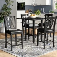 Casual dining never looked so good! Give the kids a spot to enjoy their morning meals before school and gather around friends for happy hour with this five-piece counter height dining set. Each piece is constructed from wood, featuring a black finish for versatility. Its square table features two open shelves for keeping dinnerware and napkins on hand. Plus, each stool lends decorative appeal and comfort with openwork back and leather-upholstered seats.