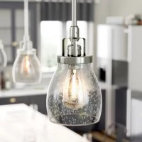 This one-light mini pendant offered in an heirloom bronze or brushed nickel finish is influenced by the vintage industrial designs of early 20th Century America. This transitional fixture is meant to be functional anywhere you need it in your space. The seeded glass shades can add a layer of retro design when paired with the classic Edison bulbs.