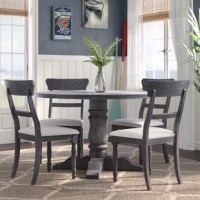 Update your eat-in kitchen or smaller dining room with this five-piece dining set. It includes four chairs with ladder-inspired backs and turned front legs, along with a round white table that sits atop a pedestal base. This set's design is perfect for homes from transitional to traditional, and blends in with a variety of color schemes.