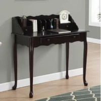 Offering the utility of a desk with the style of a vanity, this design is a versatile addition to any ensemble. Founded atop four cabriole legs, its frame is crafted from wood and features a neutral solid finish. Pull a chair or stool up to get to work, then take advantage of three drawers, two shelves, and center dividers for storage space.
