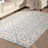 Perfect for adding a pop of pattern to your patio or entryway, this on-trend area rug showcases a contemporary scrolling medallion motif in cream and robin's egg blue hues. Hand-hooked in Turkey from 100% polypropylene, this durable design features a low 0.2