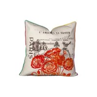 The Paris Flock Cotton Throw Pillow features velvet poppies, colorful piping, and French accents reminiscent of a romantic weekend in the city and drives through the French countryside.