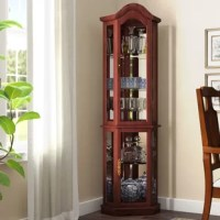 Put a collection of antiqued curios on display or simply organize your serveware for dinner parties and festive family feasts with this cabinet. Standing 70.1'' tall, its frame is crafted from solid and manufactured wood with a cherry finish. The arched top defines its angled silhouette that fits into a corner, while each of the six shelves inside are given depth and dimension with a mirrored back. Assembly for this product is required.