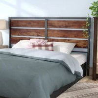 Bursting with a rustic flair, this headboard will have you hitting the hay in style. Its manufactured wood frame takes on a weathered appearance, while powder-coated metal accents form the rest of the design to keep this design grounded. Brass button details round out the look by adding a hint of warmth. This frame is compatible with most queen size beds and measures 48