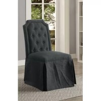 Add a charming accent to your dining or living room with this Sickmeier Upholstered Dining Chair Set. Gorgeous fabric wraps the corner cut backrest while diamond pattern tufts add lovely detail. Panel skirts distinguish the base, adding airflow to the complete the look.