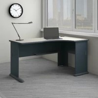 The Bush Business Furniture Series A Corner Desk maximizes your small office space with a convenient design and commercial-grade quality. Ideal for use in a corner, the Writing desk provides a comfortable curved work area, and a C-Leg design creates plenty of legroom. A scratch-resistant thermally fused laminate surface and durable end panels fend off damage, while sturdy feet with adjustable levelers ensure stability. Keep your cables in order with a comprehensive wire management system....