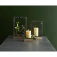 Metal framed glass cubes with weathered wood bases