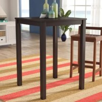 Give your eat-in kitchen or smaller dining nook a cozy, inviting atmosphere with this pub table. Crafted from solid and manufactured wood, it showcases a neutral hue with a sanded and distressed finish, providing a casually worn look for your low-key space. Square-style legs finish off the design, which is perfect for providing a cafe-style look in a compact space. Measures 42'' H x 30'' L x 30'' W and works best with 26'' stools.
