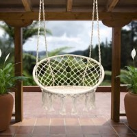 Swing into relaxation with the chair! This trendy Cottle Hanging Rope Swing Chair hammock is the perfect addition to your home, patio, or garden. It features a sturdy frame for durability with tasteful bohemian style for a casual-retro touch. When you're ready to relax and unwind, hang it from any sturdy overhang to create a cozy resting spot. It's versatile enough to function as hammock chair for lounging or to display as a unique centerpiece.