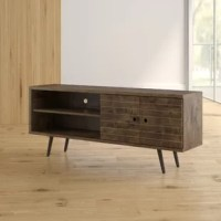 Defined by its low profile and streamlined silhouette, this TV stand is brimming with a mid-century modern flair. Founded atop four splayed legs. An open shelf on one side provides a place for the DVD player and a collection of movies, while a two-door cabinet on the other offers out-of-sight storage for any odds and ends you want to tuck away.