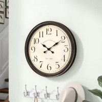 Clocks aren't just for keeping your eye on the hour! Take this one for example: showcasing a traditional dial with oversized numbers and circular metal frame finished in aged black, it makes a fine finishing touch for any classic entryway ensemble or farmhouse kitchen. Spanning 24.5'' in diameter, it's sure to make a statement in both style and size on any wall. Requires one AA battery to operate, which is not included.
