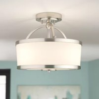 When it comes to good lighting, your fixture can make it or break it. Find the light you love with this semi-flush mount! Crafted from metal, it features curving arms and comes awash in a satin nickel finish, working well in any contemporary setting. A white glass drum shade diffuses light from any two compatible bulbs up to 100 W, while its compatibility with a dimmer switch lets you set the perfect mood.