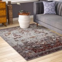 With its degraded print and rustic red and gray color scheme, this oriental area rug is an industrial update on a traditional design. Made in Turkey, this area rug is machine-woven of stain- and fade-resistant polypropylene in a medium 0.43