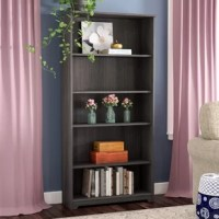 Though it's certainly stunning with your collection of reads on display in the den, this beautiful bookcase can do so much more than holding books! Clean-lined and classic, it is crafted of wood with a solid finish so it can beautifully blend into any ensemble. Exploring organization options in the entryway? Just set this pleasant piece across from the front door to greet guests, then fill its five shelves with woven wicker bins so you can stow cold-weather accessories and pet leashes in...